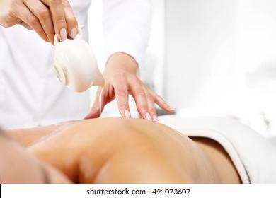 Manual massage with body butter. Back massage, aromatic oil massage