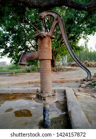Manual operated hand pump. A hand pump used for supply ground water in Indian villages. Indian vintage hand pump. old rusty water hand pump. Nal (tap) for supplying Pani (Drinking water).