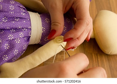 Manual production of sewing dolls.