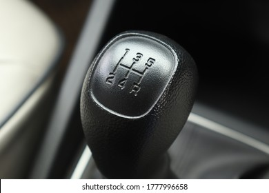 Manual Transmission Driving. Modern car with stick shift transmission. Gearstick.