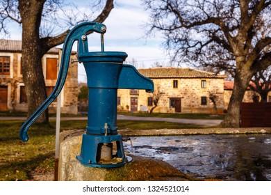Manual water pump.