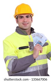Manual worker holding money