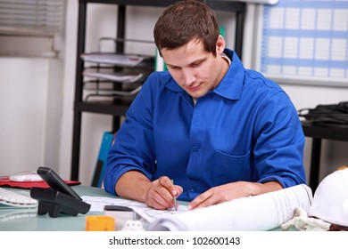 Manual worker in office ordering parts