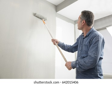 Manual Worker Painting House Interior