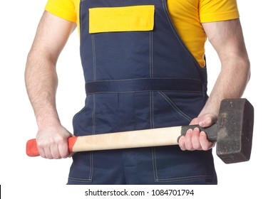 A manual worker with a sledgehammer. Isolated on white background.