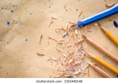 Manually sharpened pencils with office cutter on workshop table, with text space