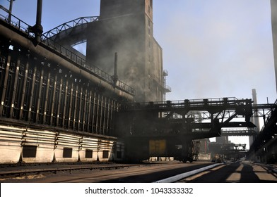 Manufacture of coke in a coke oven battery. In the front zone. Coke-pusher Avdeevka 2017.