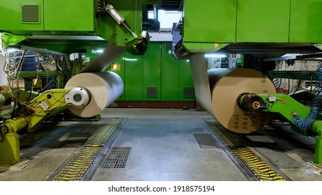 Manufacture of corrugated paper and containers of paper and paperboard. Large rolls of paper. The gap of paper.