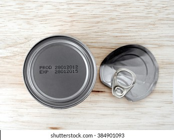 manufacture date and expiry date printed on the bottom of aluminum cans on wooden background, Information of product for consumer, top view