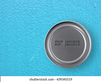 manufacture date and expiry date printed on the bottom of aluminum cans on blue cement table background, Information of product for consumer, top view