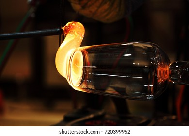 Manufacture of glassware / Someone is manufacturing glass products.