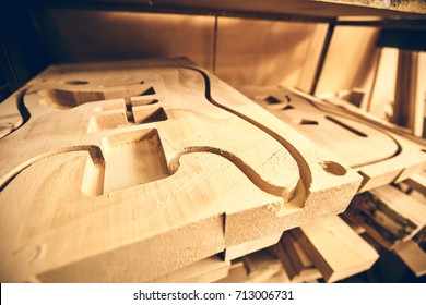 Manufacture of guitars. Guitar decks after milling on a machine with numerical program control.