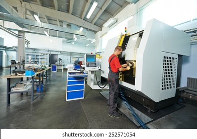 manufacture technician worker at factory metal machining shop
