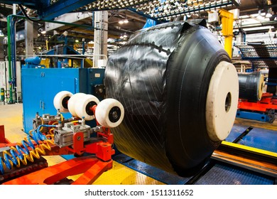 Manufacture of tires. Tyre production machine conveyor