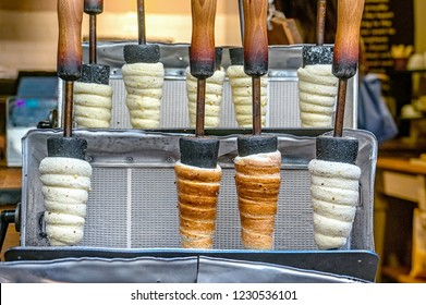 Manufacturer trdelnik in a cafe on the streets of Prague. Selective focus