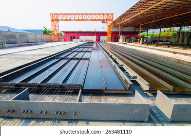 Manufacturing concrete slabs.