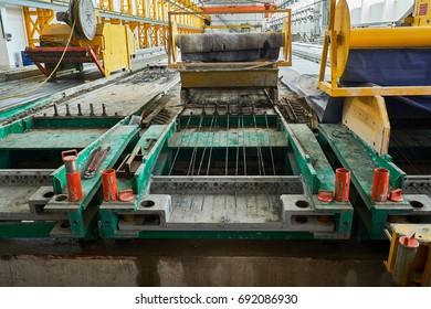 Manufacturing concrete slabs. reinforced concrete production