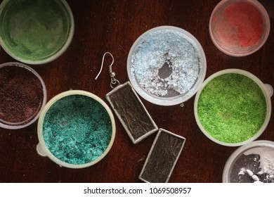 Manufacturing of decorations from enamel, creative process, tools and jars with enamel, concept background and creativity