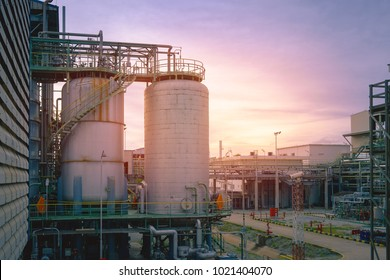 Manufacturing of Petrochemical plant with Reactor tank on sunset sky background