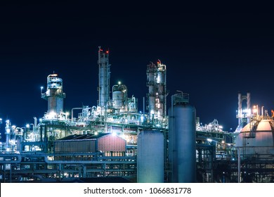 Manufacturing of petroleum industrial plant with gas tanks at night