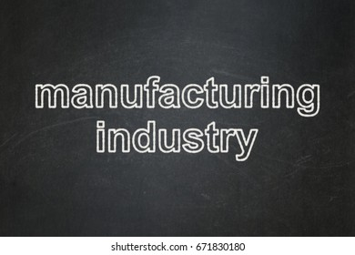 Manufacuring concept: text Manufacturing Industry on Black chalkboard background