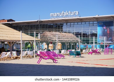 MANUFAKTURA , LODZ, POLAND, JULY 03  2019 :Inner square of Manufaktura, an arts centre, shopping mall, and leisure complex in Lodz.Artificial beach