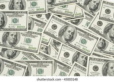 many 100 dollar bills spread out