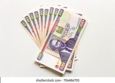 Many 100 Kenyan shilling notes.