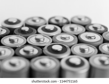 Many AA batteries (aka Double A) for electronic devices in black and white