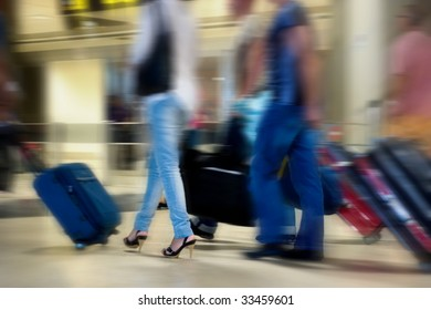 Many Airline Passengers Moving in the Airport