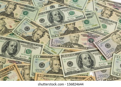 many american dollar bills. symbolic photo for debt and wealth