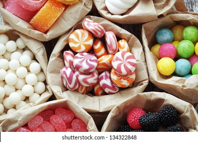 Many assorted sweet sugar candies on vintage wooden background top view point