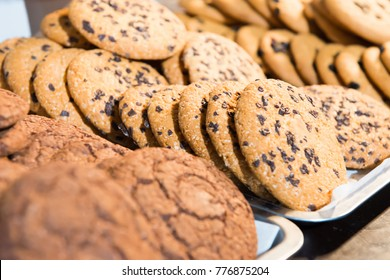 Many baked chokolate cookies on the table
