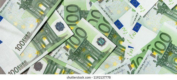 many banknotes of 100 Euro, the European currency, the concept of income and inflation