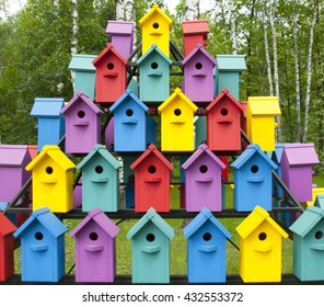 Many beautiful birdhouses in the forest