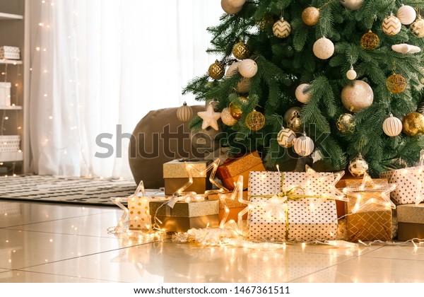 Many beautiful gift boxes under Christmas tree