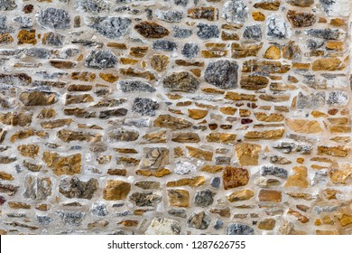 Many beautiful stones are part of a wall in an old Spanish mission near San Antonio, Texas.