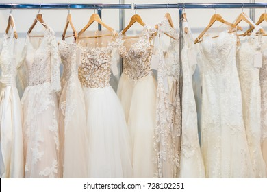 1b7e2d9162 Many beautiful wedding dresses hang in the store