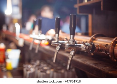 Many beer taps in the beer bar