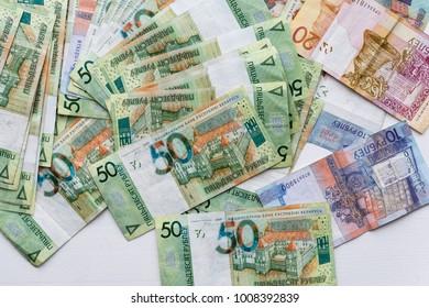 Many Belarusian money. Paper. Background. Poverty.