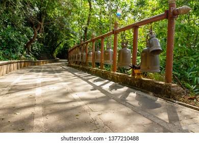 many bells on walk way in Doi Tung Temple, chiangmai Thailand