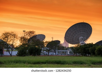 many big satelite dishes against twilight sky at sunset. Telecommunication Technology concept with copy space for text.