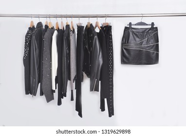 Many  black different clothing , set of on the racks