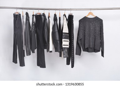 Many black different clothing , set of on hanger