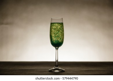 Many blue bubbles in tall champagne glass
