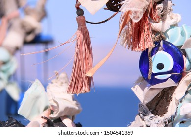 many blue evil eye beads