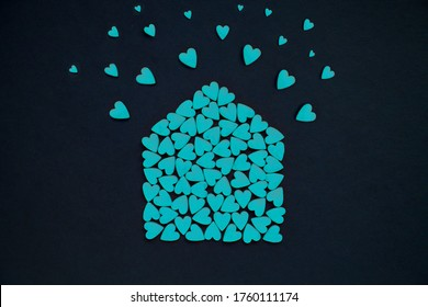 Many blue hearts in the form of house. House full of love concept