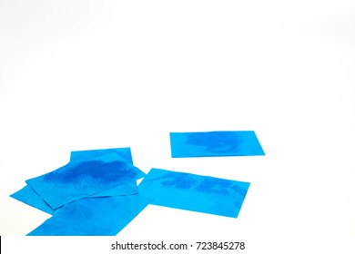 Many of blue Oil absorbing blotting sheets to remove excess oil on oily face, isolated on white background