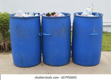many blue trash can near the road