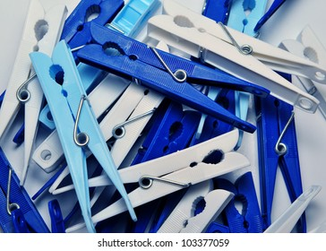 Many blue and white plastic clothes pins
